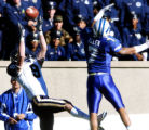 Austin Collie, left, of BYU pulls in a touchdown just past defender Nate Allen of Air Force at the...