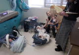 Denver, Colorado.  March 31 and april 1. Triplets.  Linda Bateman holds her daughter Savanna, 1...