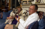 (Arvada, Colo., October 8, 2004)  Wally Gulden and his wife, Connie,  relax with their Shih...