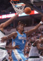 Minneapolis, Minn., April 18, 2004- Nuggets forward, Rodney White, gets blocked from behind as he...