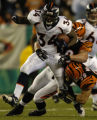 (Cincinnati, Ohio, October 25, 2004) Rueben Droughns runs hard in the 2ndGame action   of the...