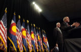 (10/08/2004) Denver-President George W. Bush, flanked by Senate candidate Pete Coors, speaks to...
