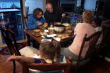 (Highlands Ranch, Colo., Oct. 19, 2004) -- Mikayla McCoy, 13, upper left, has dinner with her...