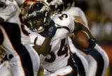 (Cincinnati, Ohio, October 25, 2004) Reuben Droughns runs  in the first quarter of the Denver...