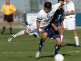 (ARVADA, CO. OCTOBER 12, 2004) Golden's Eric Lyman (8) goes airborne after colliding with...