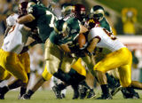 Colorado State University running back Uldis Januarajs, 22, pushes his way through the Minnesota...