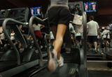 (10/13/04, Denver, CO)  People were working out and watching the debate at the 24 Hour Fitness...