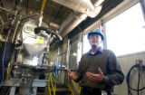 (BOULDER, CO., OCTOBER 28, 2004) ROCHE production manager Ross Lundman, talks about the machine...