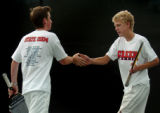 (DENVER., CO., OCTOBER 14, 2004) Cherry Creek's Andy Benson, right, celebrates with teammate Tyler...