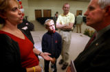 (DENVER, CO. OCTOBER 14, 2004) (Foreground Lt. to Rt.) Diane Summers, of Denver, and her son Doni...