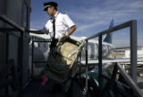 (DENVER, Colo., SHOT 10/05/04) Frontier pilots perform many tasks that other airline pilots don't....