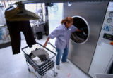 (DENVER, CO., OCTOBER 28, 2004) Noreen Claitt, Revolution Cleaners plant manager loads the GeneSys...