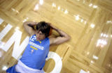 Minneapolis, Minn., photo taken April 19, 2004-Nuggets  forward Chris Anderson  streches before...