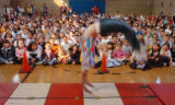 (10/15/04, Denver, CO)  Godsman Elementary students got to see a performance of acrobats and...