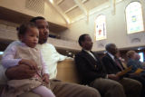 (Denver, Colo., October 31, 2004) John R. Young Jr., left, holds his daughter Selaya Young, 3,...