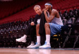 Minneapolis, Minn., photo taken April 19, 2004-Nuggets assistant coach John MacLeod (left) and...