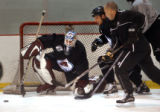 Denver, CO., April 19, 2004. (center) Colorado Avalanche goalie Tommy Salo, blocks an attempted...