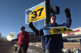 (DENVER, Colo., Nov. 2, 2004) Supporters of amendment 37, Rob Sargent, left, and Justin Dawe,...
