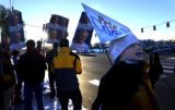 Denver, Colo.,2/11/04-- At University and Hampden, Coors and Bush signs waved as supporters came...