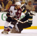 (DALLAS, TX., APRIL 12, 2004)  Colorado Avalanche's #21, Peter Forsberg, left, looks over his...