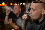 11/03/2004 WESTMINSTER, Colo.- (L-R)  Ryan Wilson and Mike Hannon smoke their cigarettes at ...