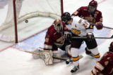 **SPECIAL TO ROCKY MOUNTAIN NEWS**  University of Denver Pioneers at University of Minnesota...
