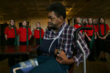 Leo Gilford, 56, a resident of the Barth Hotel, listens to the Celebration Singers from the...