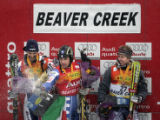 Italian skiier Giorgio Rocca (center) sprays champagne on the crowd at the awards ceremony after...