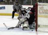 Sabres Goalie Martin Biron watches a puck go in to score as  Avs #40 Marek Svatos made a penalty...