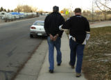 Broomfield Police officer Randy Lieser, right, brings Harold Lee Gardner, left, to his police car...