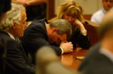 Grand Junction, CO., April 16, 2004. (lt. to rt.) Blagg Defense Attourneys David Eisner, listened...