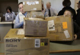 Shannon Kerth (cq) and her son Andrew Kerth (cq) from Highlands Ranch, gather their boxes to mail...