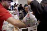(DENVER., Colo., Dec. 19, 2005) Miriam Felt (center-cq) watches as her gift bags are placed in a...