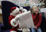 "(Denver, Colorado, 12/5/2005) Barry Howery (cq) has been playing the ""Signing Santa"" for..."