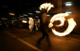A memebr of the Firemancer fire-dancing trupe with Doug Bates entertain the croud during the 2005...