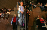 Kelsey Drogowski, cq, 8, center, shines as a float arives at the corner of 17th and Curtis with...