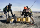 CDOT employees (L-R) Dustin Spencer (cq) and Gary Ramsier (cq) brave frigid temperatures and wind...