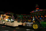 A float depicting the birth of Jesus, sponsored by a constortium of area churches files past the...