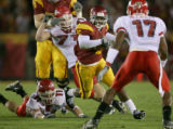 104655.SP.1119.usc5.WJS  USC tailback Reggie Bush eludes Fresno St. tacklers in the second quarter...
