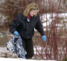 Denver Medical Examiner Tracey Balbin (cq) removes the coat of a man found frozen to death in the...