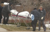 Denver coroner removes a man found frozen to death in the 4800 block of West Virginia Avenue on...