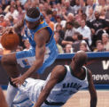 Minneapolis, Minn., April 18, 2004- Nuggets forward, Carmelo Anthony, falls to the floor while...