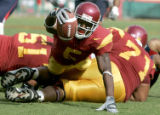 University of Southern California Trojan Reggie Bush reaches for the goal, but gets tripped up by...