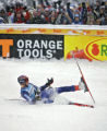 American skiier Bode Miller reacts while sliding into the finish area after a wild run that put...
