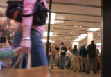 An unidentified shopper passes the Apple store at the Cherry Creek Shopping Center, one of two in...