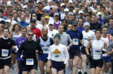 (DENVER, Colo., April 24, 2004)  Runner pour down Cherry Creek  Drive North during the start of...