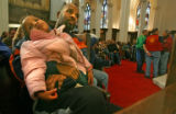 Orlando Terrell, 35, holds hid daughter Keandra Hardy, 3, in the front row during the annual C.B....