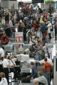 Travelers go through security at DIA Wednesday 21, 2005. A new screening procedure and changes to...