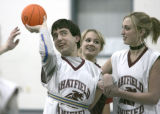 Chris Metcalf (cq), 16, left, is ancored by student partners and Chatfield High School students...