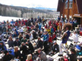 The band Boogie Machine performs in front of skiiers and snowboarders on the mountain at...